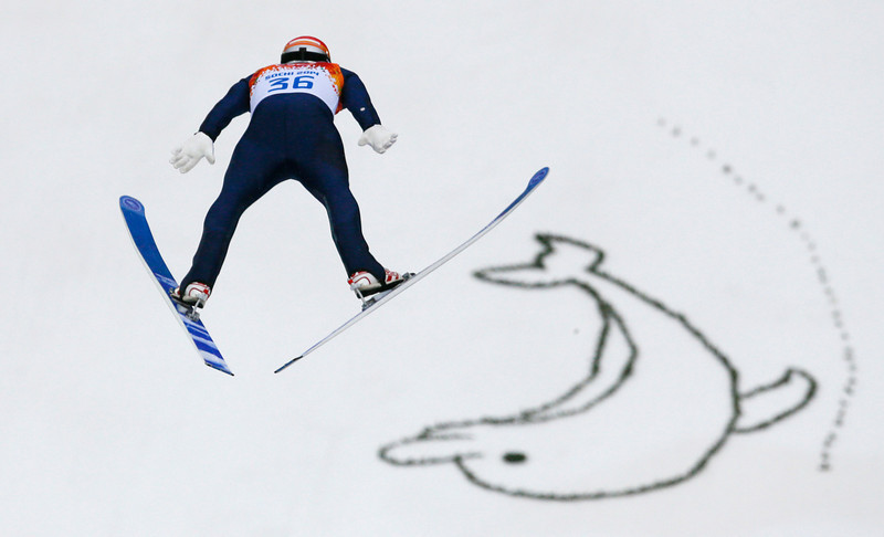 . Austria\'s Christoph Bieler makes his trial jump during the Nordic combined individual Gundersen large hill competition at the 2014 Winter Olympics, Tuesday, Feb. 18, 2014, in Krasnaya Polyana, Russia. (AP Photo/Dmitry Lovetsky)