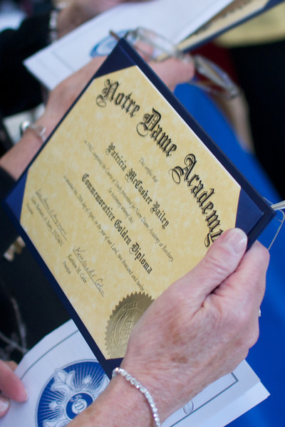 Patricia McCusker Bailey, Class of 1962, holds her commemoritive Golden Diploma