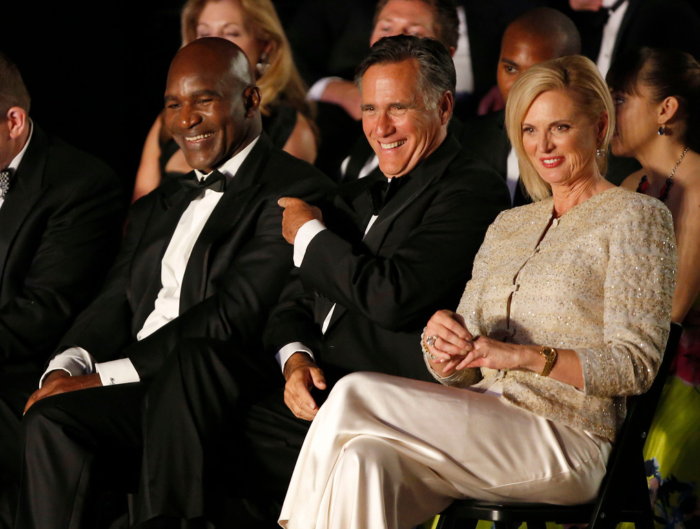 ". Evander Holyfield (L), Mitt Romney, (C) and his wife Ann Romney, (R) joke around before Romney\'s and Holyfield\'s charity boxing event on May 15, 2015 in Salt Lake City, Utah. The event was held to raise money for  ""Charity Vision\"" a charity that aims to restore sight to the blind and visually impaired. (Photo by George Frey/Getty Images)"