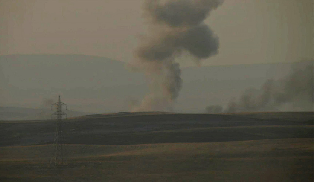 . This image made from AP video shows smoke rising from airstrikes targeting Islamic State militants near the Khazer checkpoint outside of the city of Irbil in northern Iraq, Friday, Aug. 8, 2014. (AP Photo via AP video)