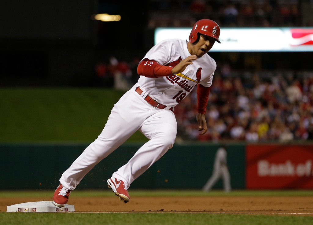 . St. Louis Cardinals\' Jon Jay rounds third and heads home to score on a single by Pete Kozma during the second inning of a baseball game against the Colorado Rockies Friday, May 10, 2013, in St. Louis. (AP Photo/Jeff Roberson)
