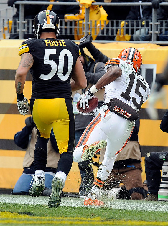 . Cleveland Browns wide receiver Greg Little (15) makes a catch for a touchdown past Pittsburgh Steelers inside linebacker Larry Foote (50) in the third quarter of an NFL football game on Sunday, Dec. 30, 2012, in Pittsburgh. (AP Photo/Don Wright)