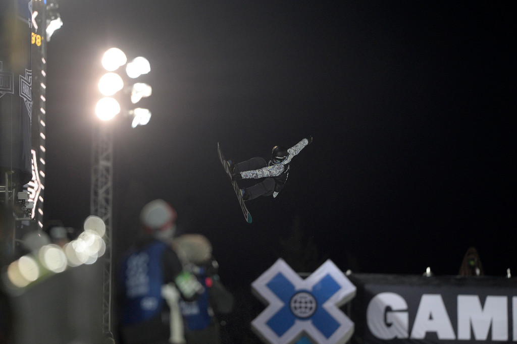 . Kelly Clark makes a grab during the women\'s snowboard half pipe final. Winter X Games on Saturday, January 24, 2015. (Photo by AAron Ontiveroz/The Denver Post)