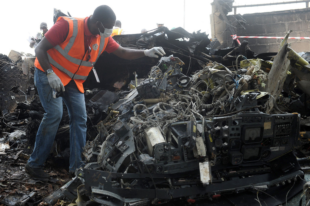 . A man looks at the wreckage of an Associated Airlines plane that crash-landed at Sahara Airport shortly after takeoff in Lagos on October 3, 2013. The Nigerian charter plane with 27 people on board suffered engine failure shortly after takeoff from Lagos, crash-landing near an airport fuel depot and killing at least nine people, officials said. AFP PHOTO/ PIUS UTOMI EKPEI/AFP/Getty Images