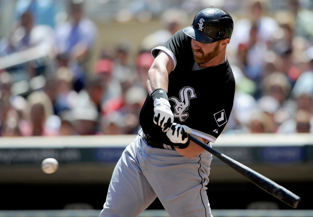. Chicago\'s Adam Dunn laces an RBI double to left field off Twins starter Mike Pelfrey during the fifth inning. Dunn\'s two-bagger knocked Pelfrey out of the game.  (Photo by Hannah Foslien/Getty Images)