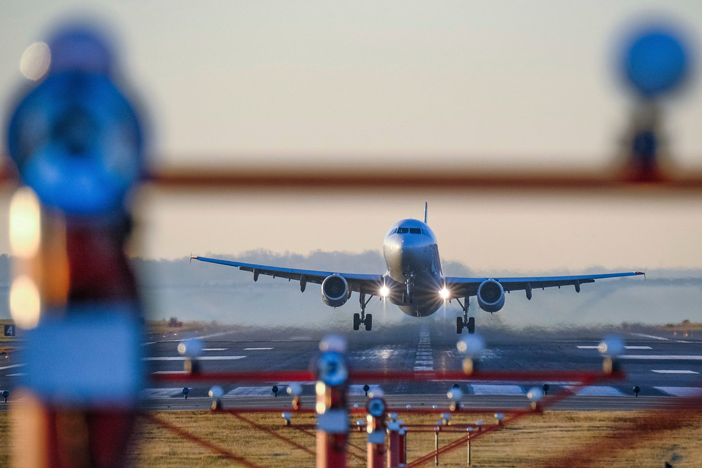 . A passenger jet takes off from Reagan National Airport, Wednesday morning, Nov. 23, 2016, in Washington, on what is expected to be the busiest travel day of the year. (AP Photo/J. David Ake)