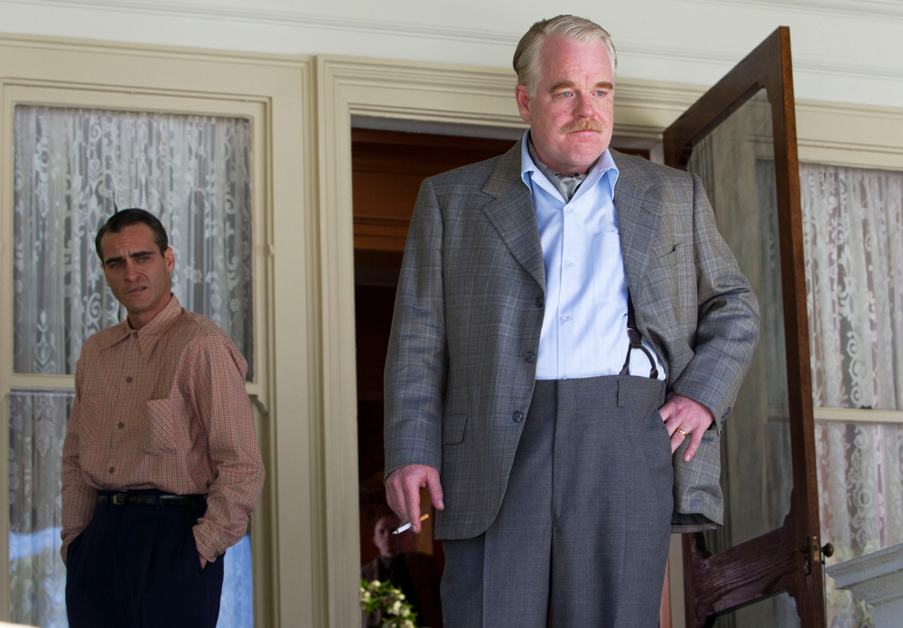 Description of . This undated file handout film image released by The Weinstein Company shows Joaquin Phoenix, left, and Philip Seymour Hoffman in a scene from