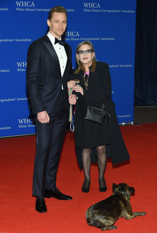 . Tom Hiddleston, left, and Carrie Fisher arrive at the White House Correspondents\' Association Dinner at the Washington Hilton Hotel on Saturday, April 30, 2016, in Washington. (Photo by Evan Agostini/Invision/AP)