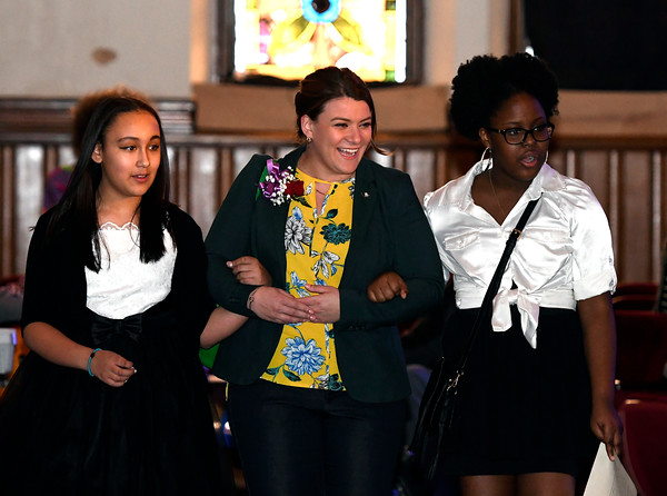 3/24/2018 Mike Orazzi | Staff New Britain Mayor Erin Stewart (center) gets escorted to her seat during The Queen Ann Nzinga Center's 9th annual Connie Wilson Collins Exceptional Women Concert, honoring outstanding women from the Greater Bristol, Plainville and New Britain community, held at Trinity on Main Saturday evening.