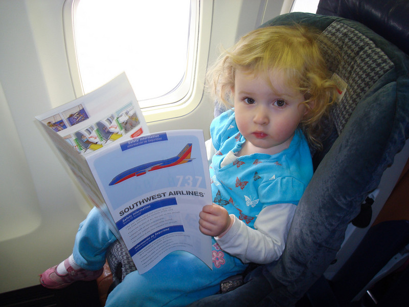 Bevelry's first plane ride - reading the safety manual is a must