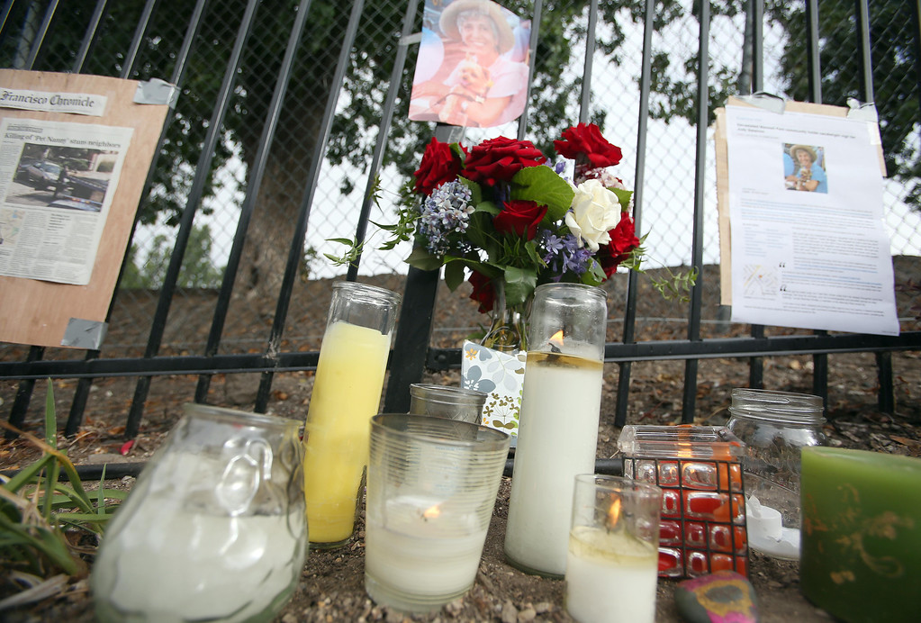 . A picture, candles, flowers and newspaper clippings are seen at a memorial for homicide victim Judy Salamon, 66, on Fern Street in Oakland, Calif., on Thursday, July 25, 2013. Salamon was shot and killed Wednesday afternoon while driving a few blocks from her home in Oakland\'s Fairfax district, marking the city\'s 56th homicide of the year. (Jane Tyska/Bay Area News Group)