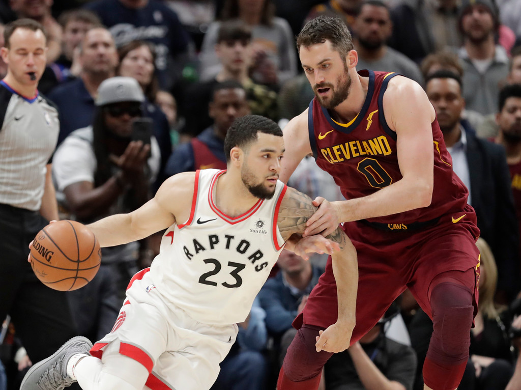 . Toronto Raptors\' Fred VanVleet (23) drives against Cleveland Cavaliers\' Kevin Love (0) during the second half of an NBA basketball game Wednesday, March 21, 2018, in Cleveland. The Cavaliers won 132-129. (AP Photo/Tony Dejak)