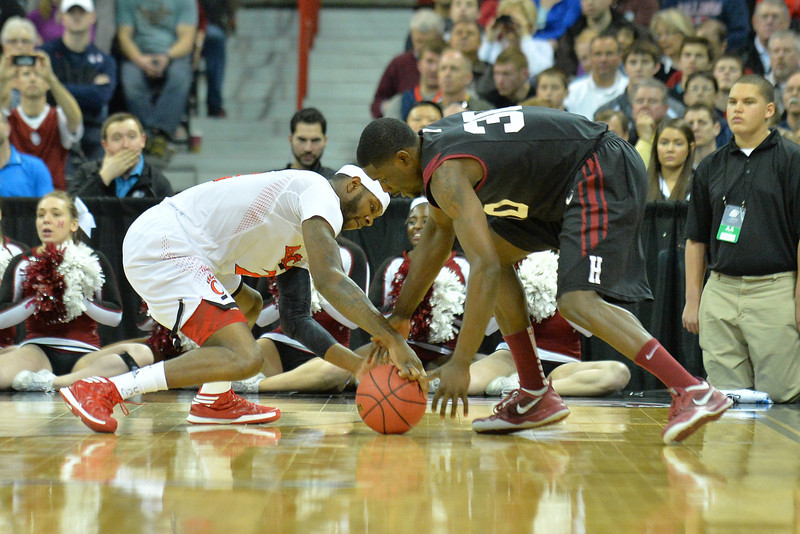March 20, 2014: Harvard Crimson forward Kyle Casey (30) and Cincinnati Bearcats forward Titus Rubles (2) battle for a loose ball during a second round game of the NCAA Division I Men's Basketball Championship between the 5-seed Cincinnati Bearcats and the 12-seed Harvard Crimson at Spokane Arena in Spokane, Wash. Harvard defeated Cincinnati 61-57.
