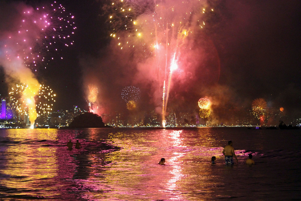 . Fireworks explode over the Acapulco bay during a New Year\'s Eve celebration in Acapulco, Mexico, Sunday, Jan. 1, 2017. At least five people were killed over the New Year\'s weekend in the Mexican resort city of Acapulco, including three men found decapitated in a central neighborhood.(AP Photo/Bernandino Hernandez)