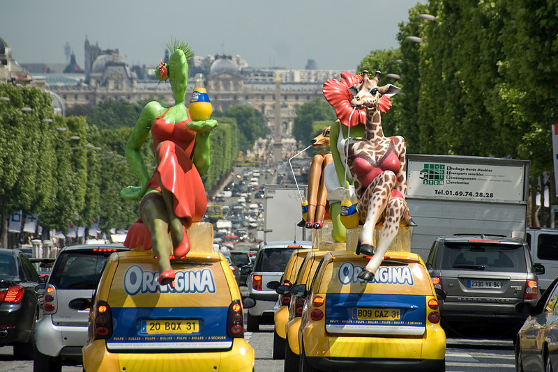 Vehicles with mascots in the street of Paris, France