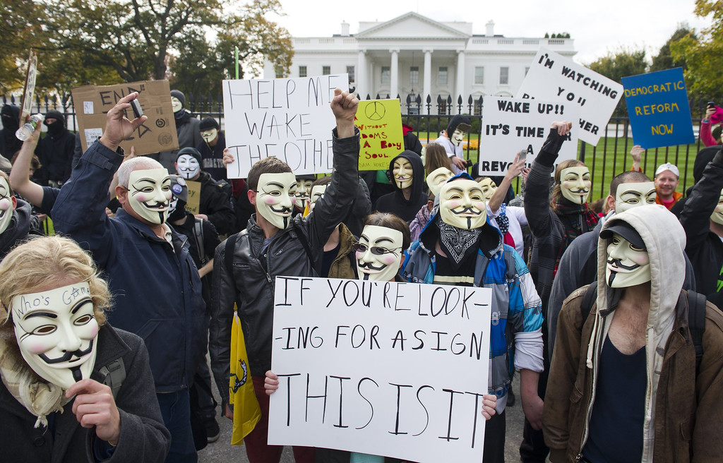 . Demonstrators, including supporters of the group Anonymous, march in a protest against corrupt governments and corporations in front of the White House in Washington, DC, November 5, 2013, as part of a Million Mask March of similar rallies around the world on Guy Fawkes Day. AFP PHOTO / Saul  LOEB/AFP/Getty Images