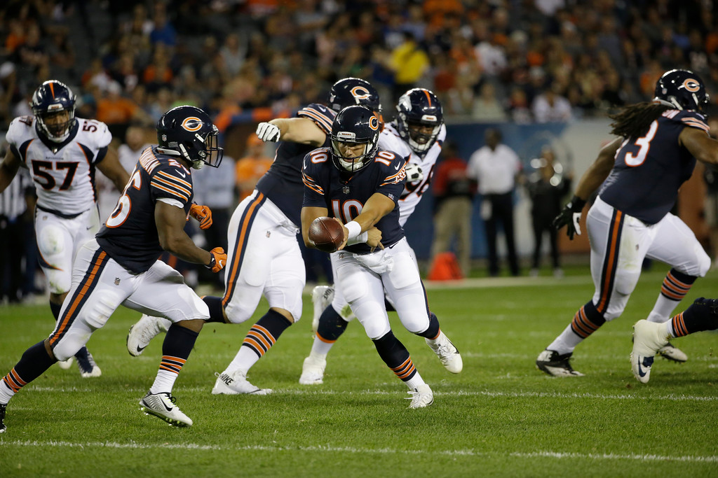 . Chicago Bears quarterback Mitchell Trubisky (10) hands off the ball to running back Benny Cunningham (26) during the second half of an NFL preseason football game against the Denver Broncos, Thursday, Aug. 10, 2017, in Chicago. (AP Photo/Nam Y. Huh)