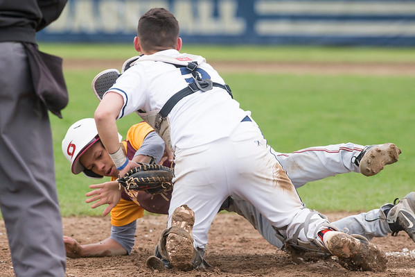 05/14/19 Wesley Bunnell | Staff Newington baseball defeated New Britain 4-3 in a walk off on Tuesday afternoon at Newington High School. Danniel Rivera (1) is tagged out at home by Gunnar Johnson (5).