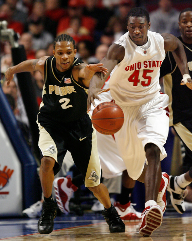 . Purdue guard David Teague (2) and Ohio State forward Othello Hunter chase after a loose ball during the first half of their Big Ten Tournament basketball semifinal game in Chicago, Saturday, March 10, 2007.  (AP Photo/Nam Y. Huh)