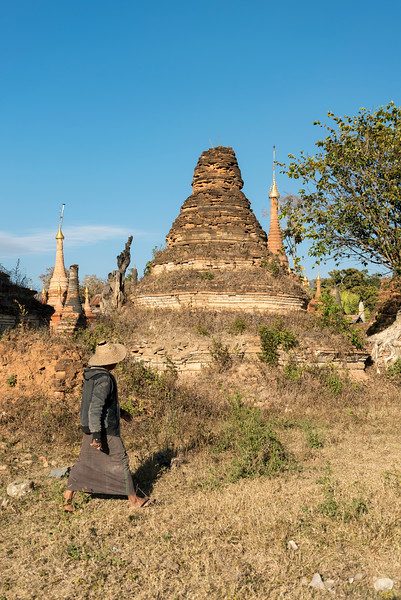 Man walks by crumbling temple (stupa) in Sankar near Inle Lake, Burma (Myanmar)