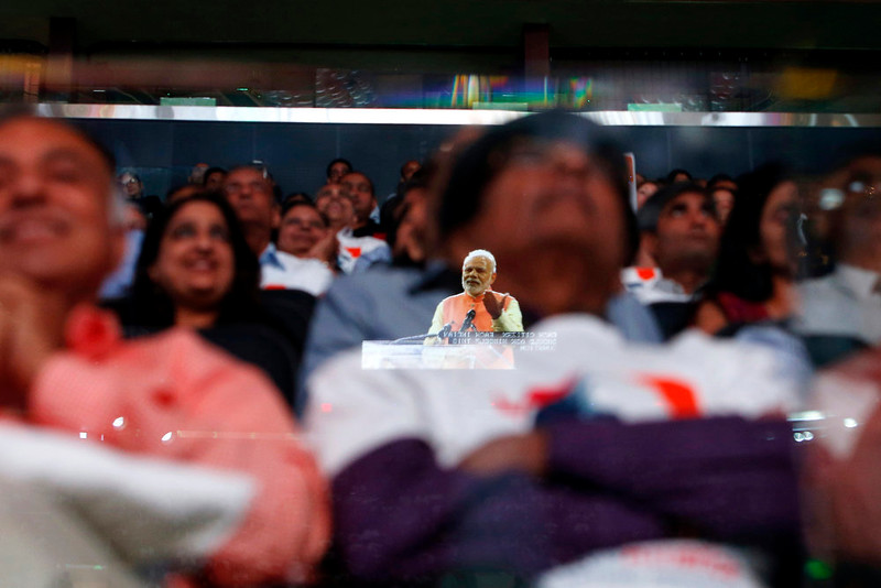 . Prime Minister Narendra Modi of India is reflected in a glass barrier as he gives a speech during a reception by the Indian community in honor of his visit to the United States at Madison Square Garden, Sunday, Sept. 28, 2014, in New York. (AP Photo/Jason DeCrow)