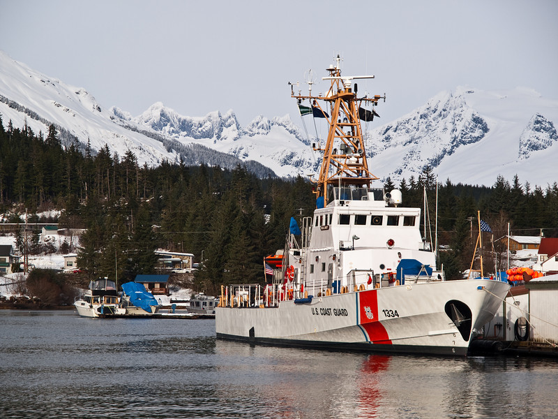A Coast Guard cutter is stationed at Stattor harbor. The coast guard performs regular rescue operations in the area. The Mendenhall Towers can be seen in the background. March 14th, 2009.