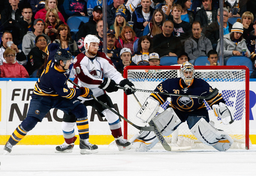 . Jamie McBain #4 of the Buffalo Sabres and Ryan O\'Reilly #90 of the Colorado Avalanche battle in front of the net as Ryan Miller #30 of Buffalo makes the save at First Niagara Center on October 19, 2013 in Buffalo, New York.  (Photo by Jen Fuller/Getty Images)