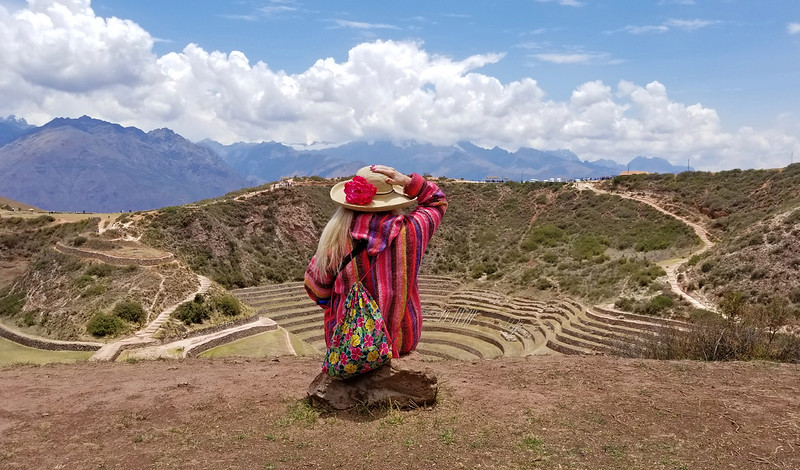 Women looking over terraced landscape in peru