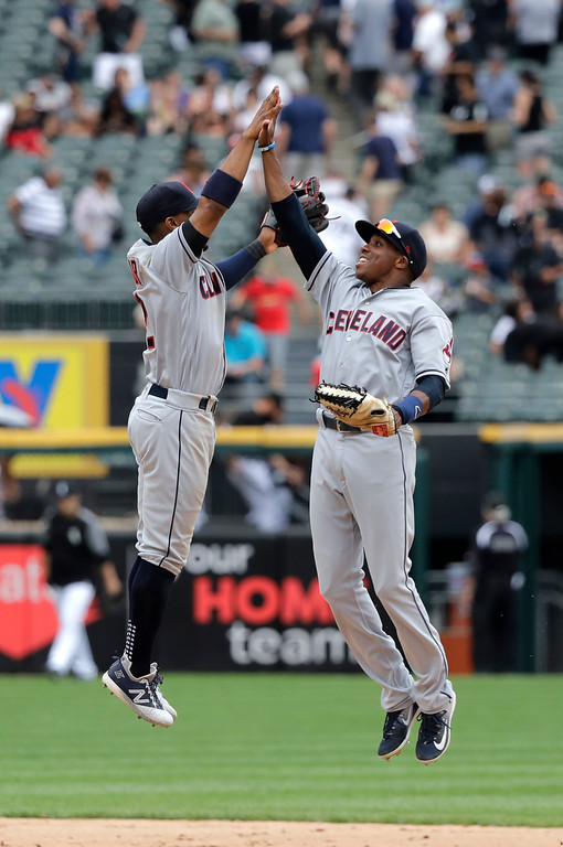 . Cleveland Indians\' Francisco Lindor, left, and Greg Allen celebrate the team\'s 5-2 win over the Chicago White Sox after a baseball game Thursday, June 14, 2018, in Chicago. (AP Photo/Charles Rex Arbogast)