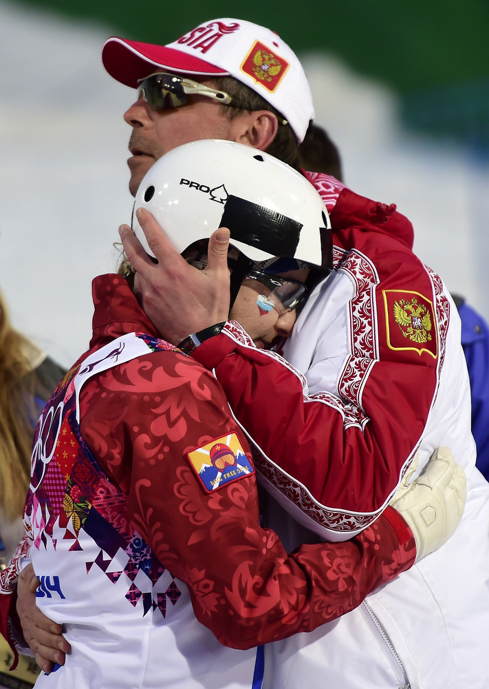 . Russia\'s Veronika Korsunova hugs a member of the Russian tean after advancing in the Women\'s Freestyle Skiing Aerials Qualifications at the Rosa Khutor Extreme Park during the Sochi Winter Olympics on February 14, 2014.  (JAVIER SORIANO/AFP/Getty Images)