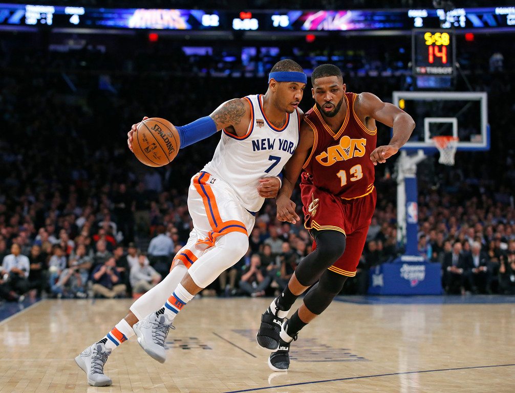 . New York Knicks forward Carmelo Anthony (7) drives to the basket with Cleveland Cavaliers center Tristan Thompson (13) in the second half of an NBA basketball game at Madison Square Garden in New York, Wednesday, Dec. 7, 2016. (AP Photo/Kathy Willens)