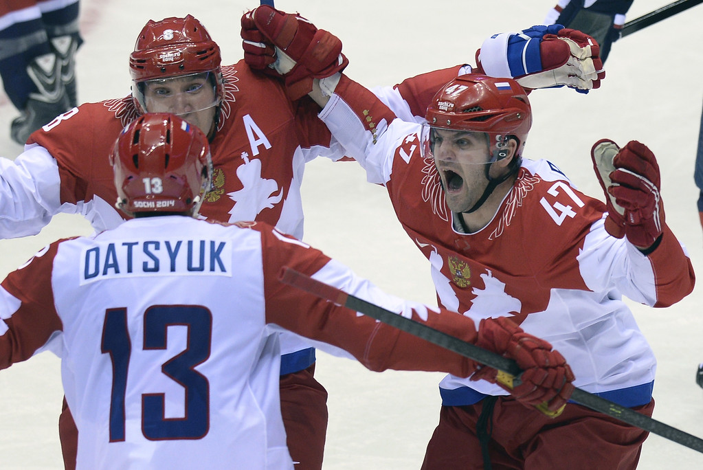. Russia\'s Alexander Ovechkin (C), Pavel Datsyuk (L) and Alexander Radulov (R) celebrate a goal during the Men\'s Ice Hockey Group A match USA vs Russia at the Bolshoy Ice Dome during the Sochi Winter Olympics on February 15, 2014 in Sochi.  US won 3-2 in the penalty shootout.    ALEXANDER NEMENOV/AFP/Getty Images