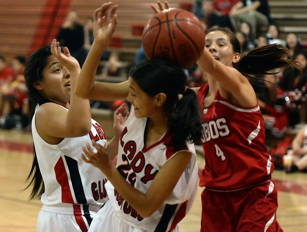 . Workman\'s Raquel Ramirez (4) rebounds over Gladstone\'s Karen Morales (24) in the first half of a prep basketball game at Gladstone High School in Covina, Calif., on Friday, Jan. 17, 2014. (Keith Birmingham Pasadena Star-News)