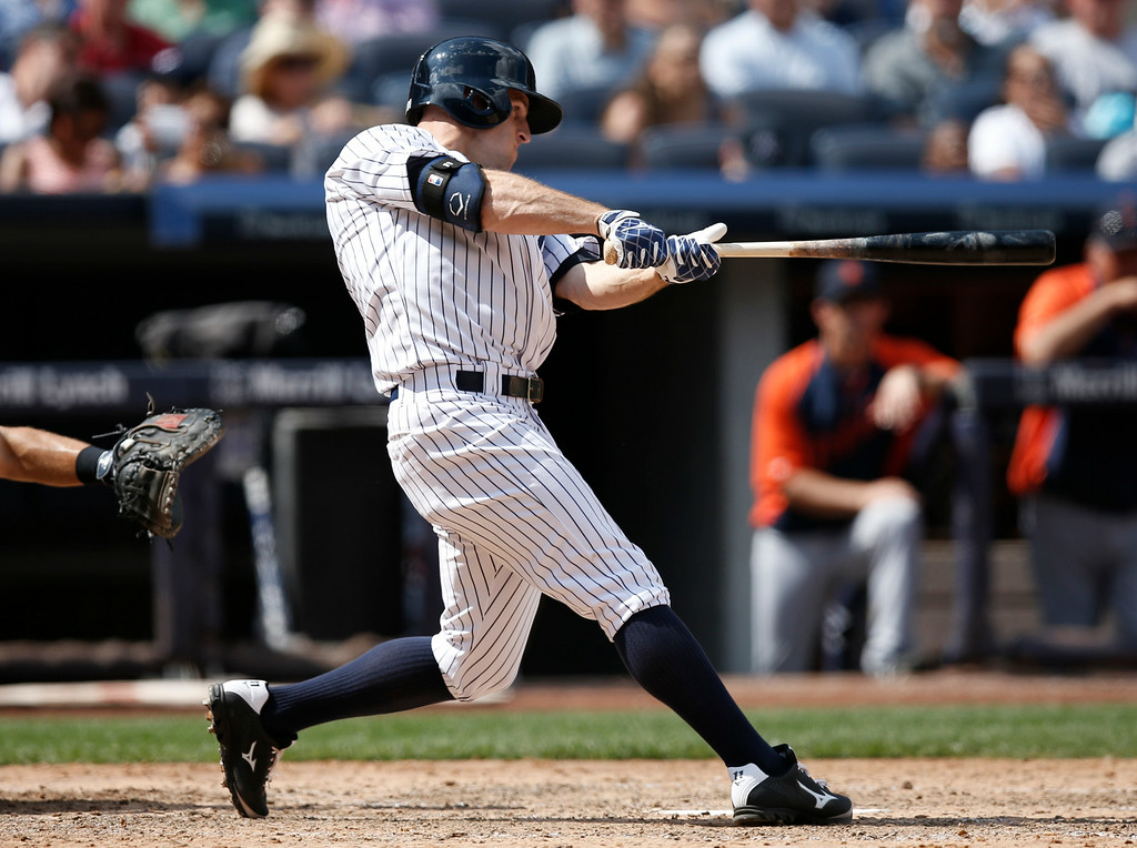 . New York Yankees Brett Gardner (11) bats in a baseball game against the Detroit Tigers at Yankee Stadium in New York, Thursday, Aug. 7, 2014.  (AP Photo/Kathy Willens)