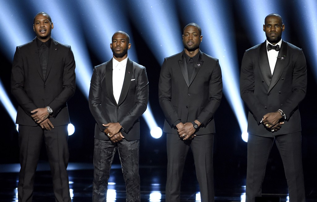 . NBA basketball players Carmelo Anthony, from left, Chris Paul, Dwyane Wade and LeBron James speak on stage at the ESPY Awards at the Microsoft Theater on Wednesday, July 13, 2016, in Los Angeles. (Photo by Chris Pizzello/Invision/AP)