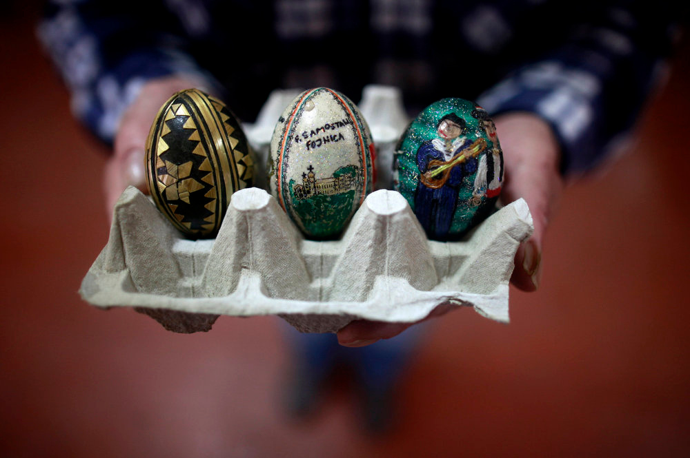 Description of . A Bosnian Catholic man shows eggs before an annual egg breaking competition after an Easter mass in Fojnica March 31, 2013. REUTERS/Dado Ruvic