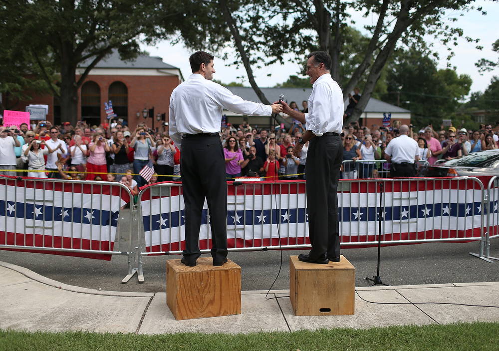 Description of . Republican presidential candidate and former Massachusetts Govermor Mitt Romney (R) and Rep. Paul Ryan (R-WI) (L) speak to an overflow crowd during a campaign rally at Randolph Macon College on August 11, 2012 in Ashland, Virginia. Mitt Romney kicked off a four day bus tour with an announcement of his running mate, Rep. Paul Ryan (R-WI).  (Photo by Justin Sullivan/Getty Images)