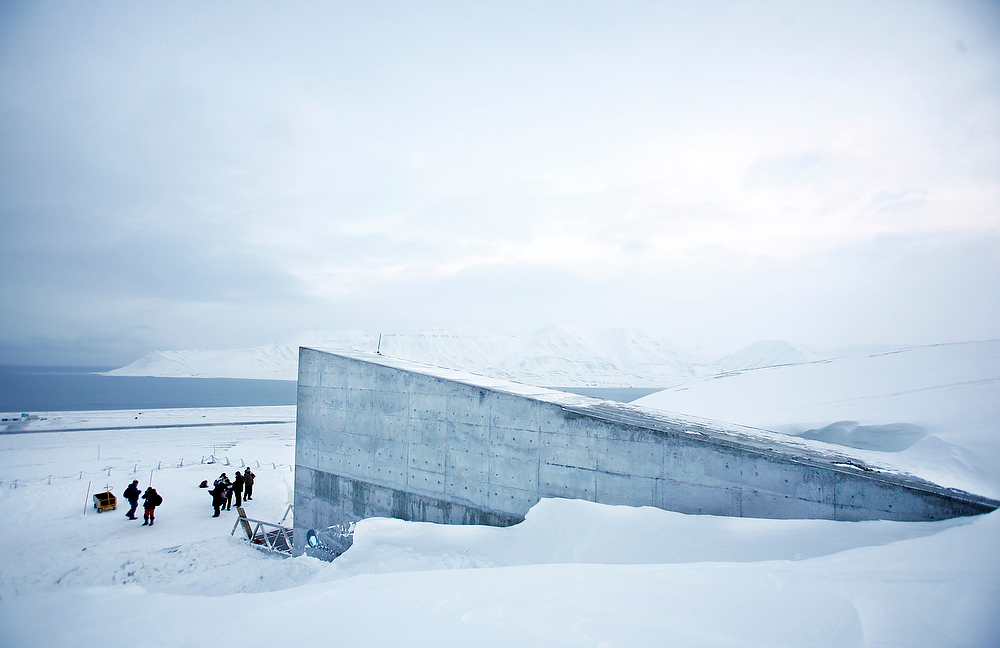 ". The Svalbard Global Seed Vault is seen Monday, Feb. 25, 2008 in Longyearbyen, Norway. A ""doomsday\"" vault built to withstand an earthquake or nuclear strike is ready to open deep in the permafrost of an Arctic mountain, where it will protect millions of agriculture seeds from man-made and natural disasters. The vault is to be officially inaugurated on Tuesday, less than year after crews started drilling in Norway\'s Svalbard archipelago, about 620 miles from the North Pole. The vault has the capacity to store 4.5 million seed samples from around the globe, shielding them from climate change, wars, natural disasters and other threats. (AP Photo/John McConnico)"