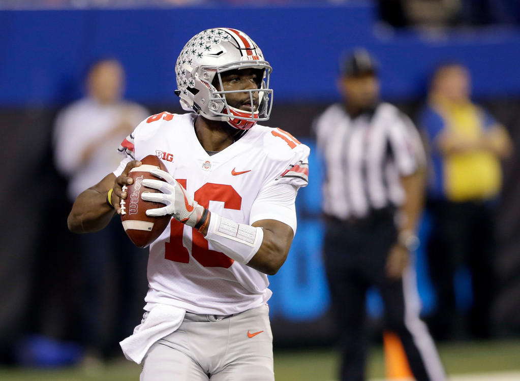 . Ohio State quarterback J.T. Barrett drops back to pass during the first half the Big Ten championship NCAA college football game against Wisconsin, Saturday, Dec. 2, 2017, in Indianapolis. (AP Photo/AJ Mast)