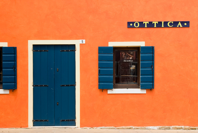 Brightly Painted House Facade with Door and Window, Historic Centre of Caorle, Veneto, Italy