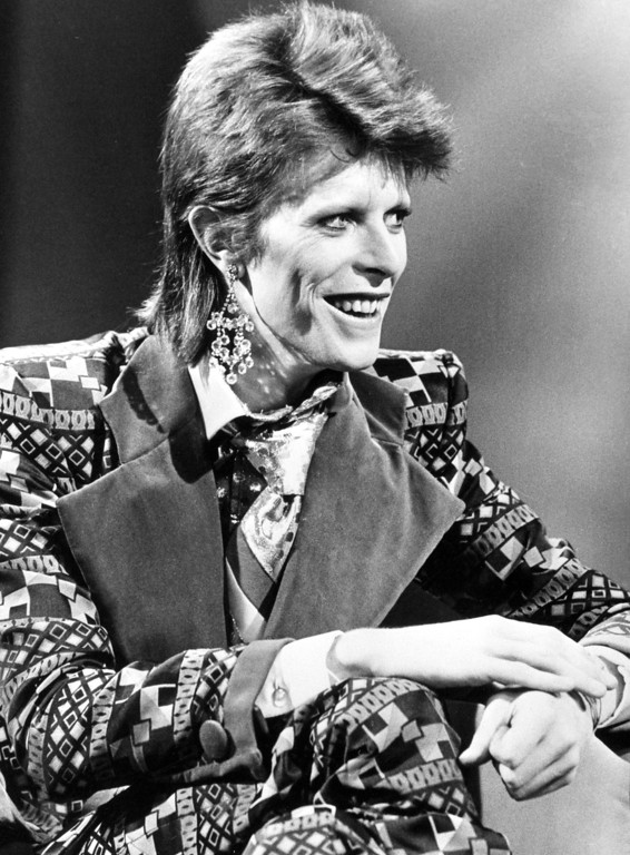 . FILE - This is a Jan. 1, 1974  file photo of David Bowie. Bowie, the other-worldly musician who broke pop and rock boundaries with his creative musicianship, nonconformity, striking visuals and a genre-bending persona he christened Ziggy Stardust, died of cancer Sunday Jan. 10, 2016. He was 69 and had just released a new album. (PA, File via AP) UNITED KINGDOM OUT  NO SALES NO ARCHIVE