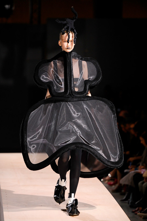 . A model presents a creation as part of Comme Des Garcons ready-to-wear Spring/Summer 2014 fashion collection, presented Saturday, Sept. 28, 2013 in Paris. (AP Photo/Zacharie Scheurer)