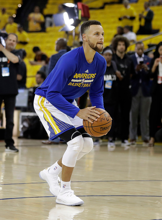 . Golden State Warriors guard Stephen Curry warms up before Game 5 of basketball\'s NBA Finals between the Warriors and the Cleveland Cavaliers in Oakland, Calif., Monday, June 12, 2017. (AP Photo/Marcio Jose Sanchez)