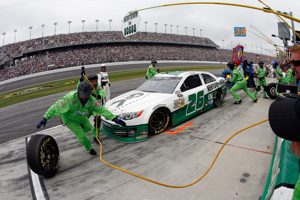 . Michael Waltrip, driver of the #26 Sandy Hook School Support Fund Toyota, pits during the NASCAR Sprint Cup Series Daytona 500 at Daytona International Speedway on February 24, 2013 in Daytona Beach, Florida.  (Photo by Chris Graythen/Getty Images)