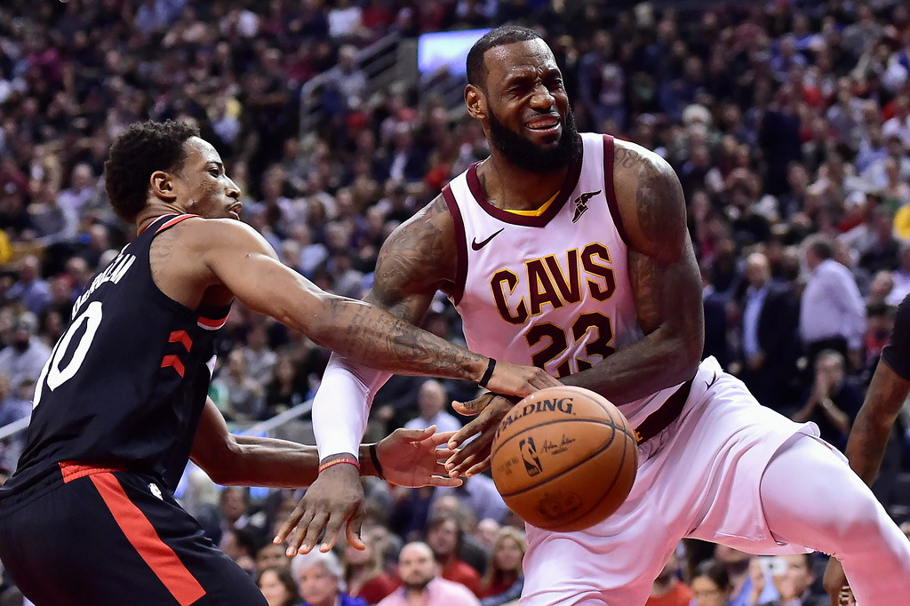 . Cleveland Cavaliers forward LeBron James (23) reacts after being fouled by Toronto Raptors guard DeMar DeRozan (10) during the second half of an NBA basketball game Thursday, Jan. 11, 2018, in Toronto. (Frank Gunn/The Canadian Press via AP)