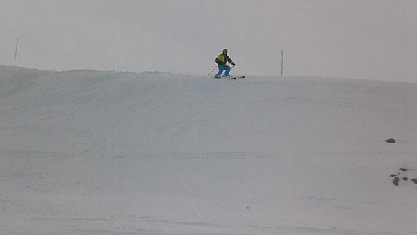 "Aaron attempting to ski down the cornice on the backside known as ""The Wave."" This is Aaron's not so good attempt (there's a much better attempt next).  Video by Harrison Turner."