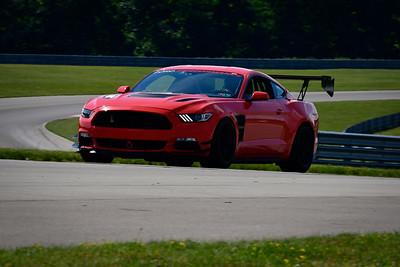 2021 SCCA TNiA June 24 Pitt Adv Orange Mustang Wing