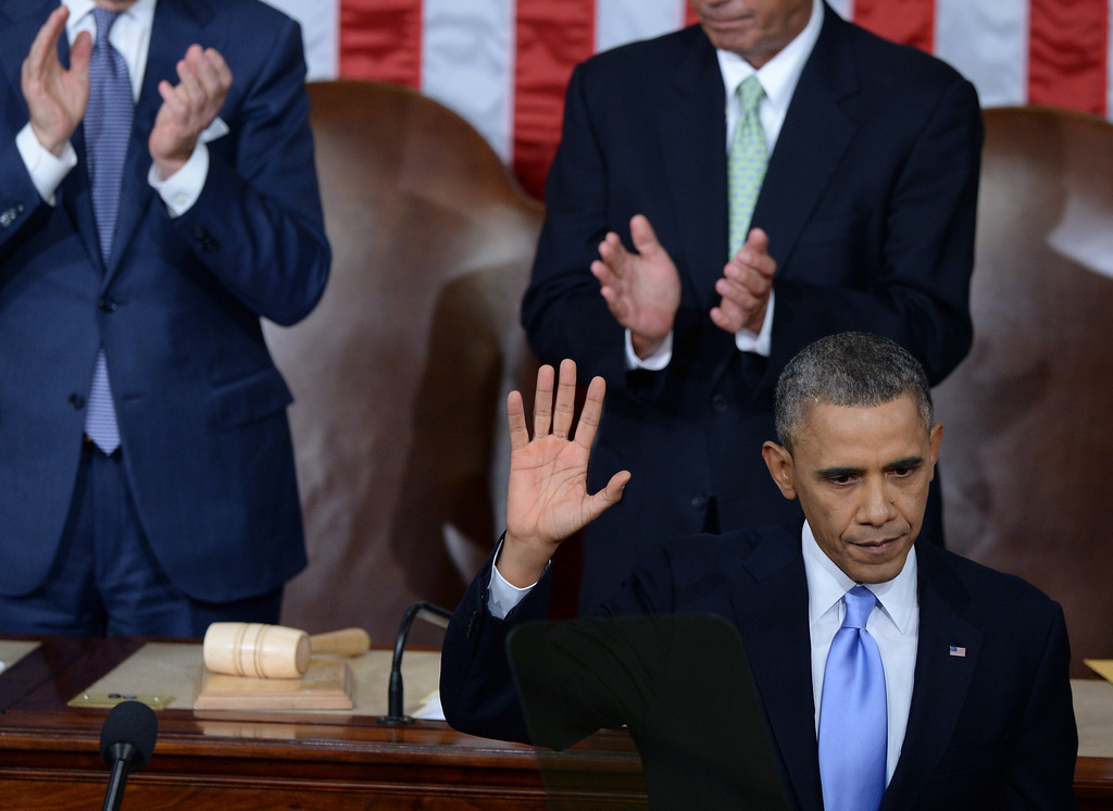 . US President Barack Obama waves after delivering the State of the Union address before a joint session of Congress on January 28, 2014 at the US Capitol in Washington.  JEWEL SAMAD/AFP/Getty Images
