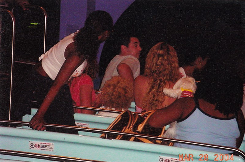 Jackie rode behind Mariah Carey on It's a Small World Ride at Disney World.