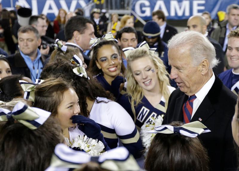 . Vice President Joe Biden meets with Navy cheerleaders after an NCAA college football game against Army Saturday, Dec. 8, 2012, in Philadelphia. Navy won 17-13. (AP Photo/Matt Rourke)